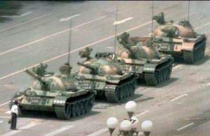An unknown man halting the PLA's advancing tanks near Tiananmen Square. Photo by Jeff Widener.